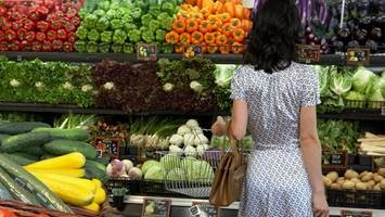 woman looking at produce